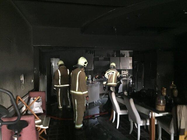آتش سوزی در ساختمان بورس تهران در سعادت آباد، مصدومیت یک آتش نشان